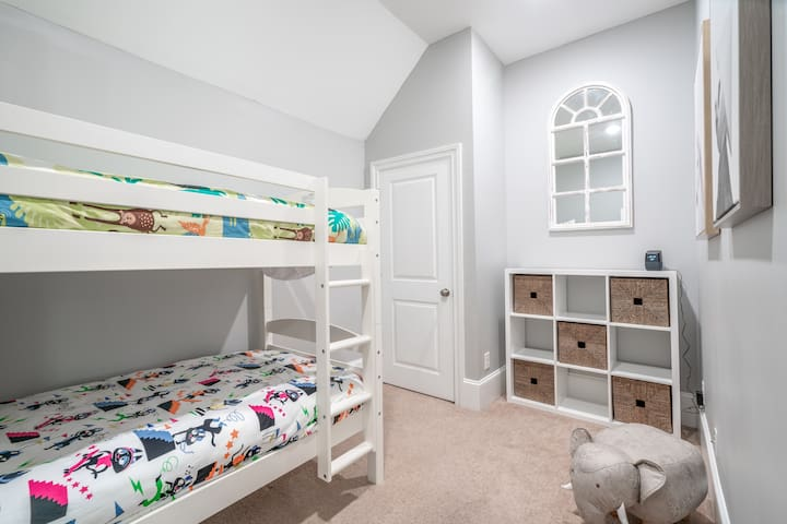 Grant Park Bedroom, named after Zoo Atlanta, is where all the animals live. We have a pack and play crib in this room.
