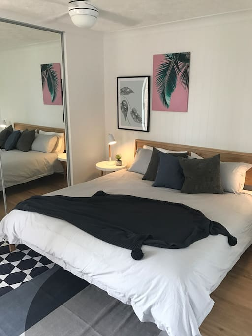 Master Bedroom with King bed and ensuite and small balcony.