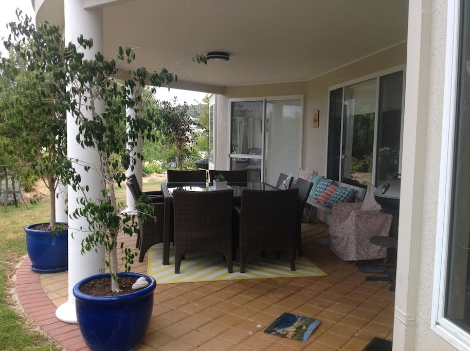 Patio area with outdoor table and 8 chairs