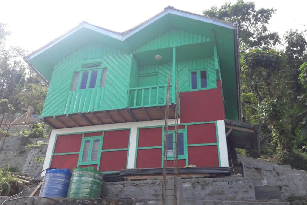 The wooden cottage with new paint, with local colors