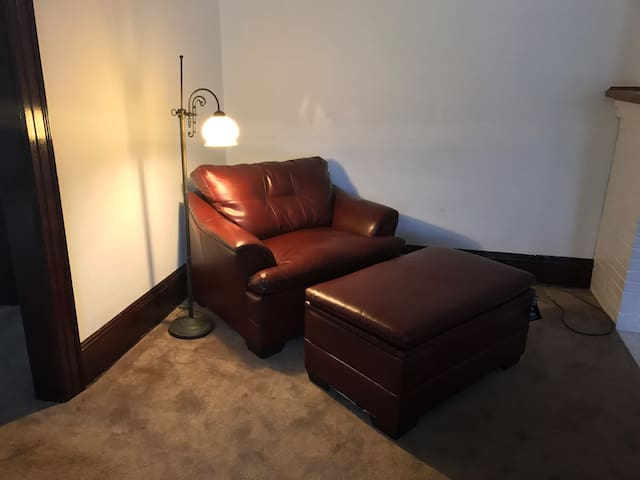 New large leather chair and ottoman.