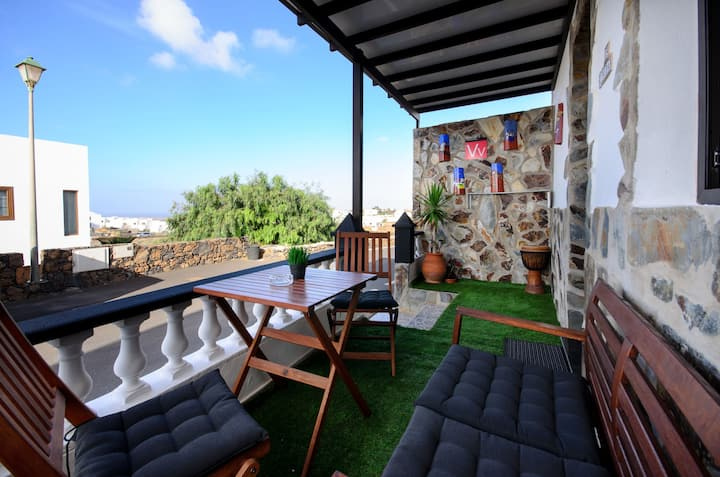 Lovely Apartment with Spacious Porch, Ocean and Mountain Views & Wi-Fi; Street Parking Available