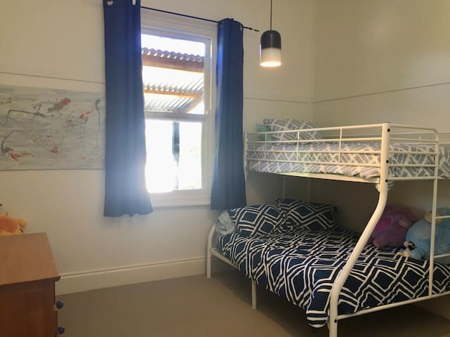 Family room - bunk bed bottom bunk double and top bunk single bed  plus extra single bed