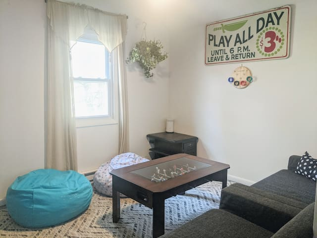 Upstairs is the family room with a table fusbol, a streaming TV (bring your logins), and two loveseats which fold out into floor mattresses, each sleeping 2. If you wanted it could be a a cozy but fun sleepover vibe for up to 4.