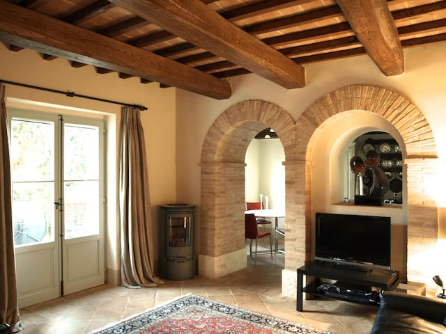 The sitting room - showing the arches through to the kitchen