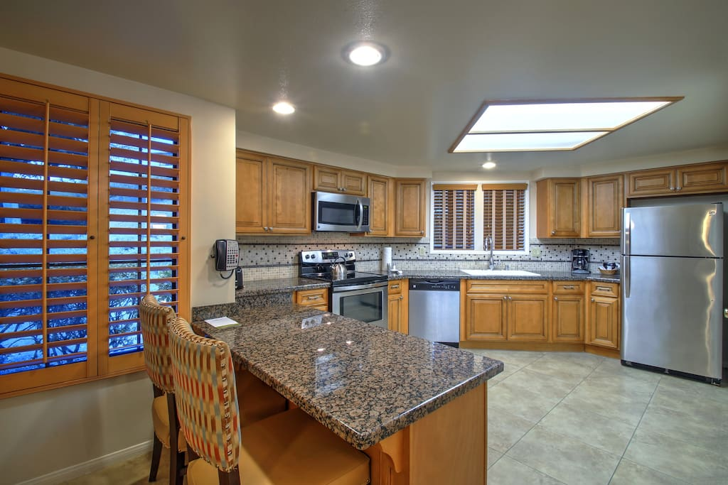 Spacious Fully-equipped Kitchen with dishwasher, microwave, stove, oven, refrigerator, stacked washer/dryer, Coffee/tea maker, cookware, dishware, and utensils