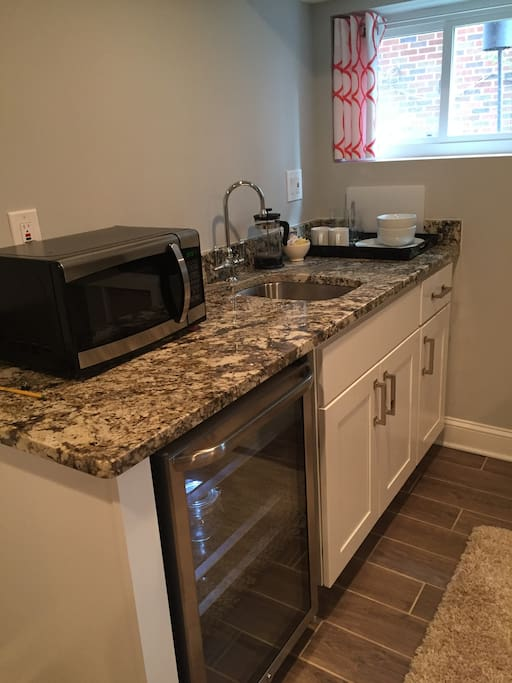 Kitchenette with microwave & sink; coffee & tea provided
