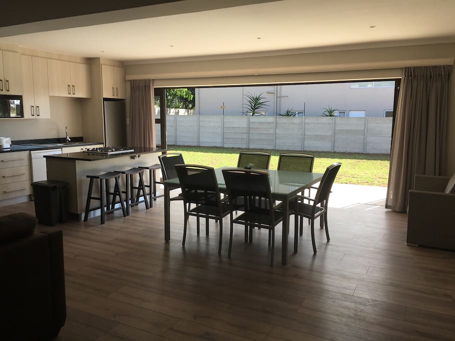 Kitchen and spacious dining room table with open stacker  doors