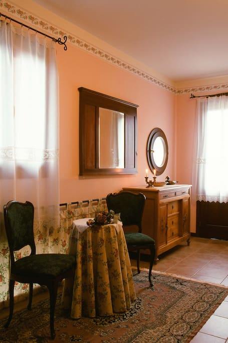 Arredamento tipico camera tripla.  Typical furniture of the triple room.