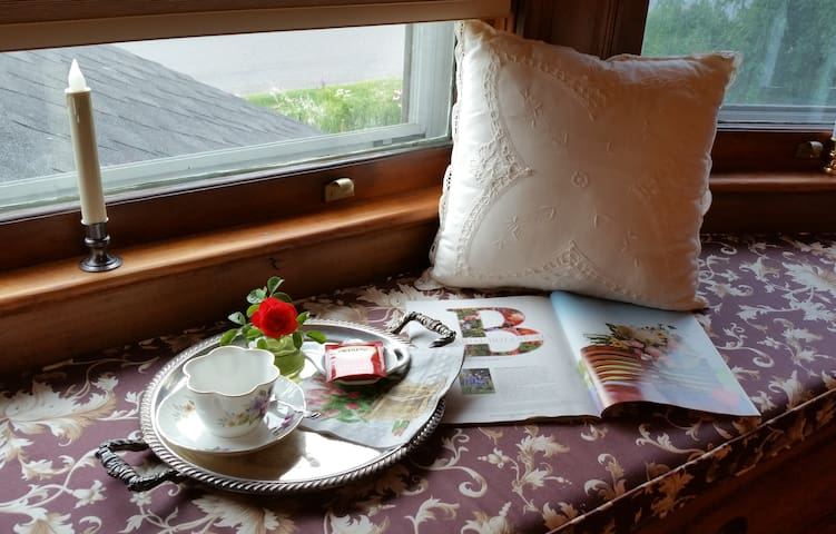 Plum Garden window seat is perfect for reading and relaxing