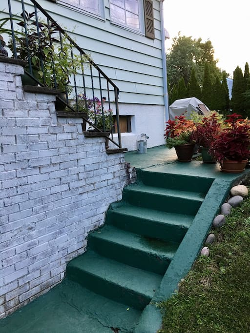 There are steps going up to the front door (your point of entry and exit) from the driveway.