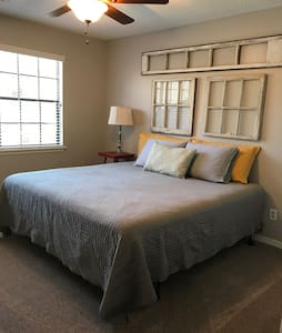 King bed with private bath. - Houston