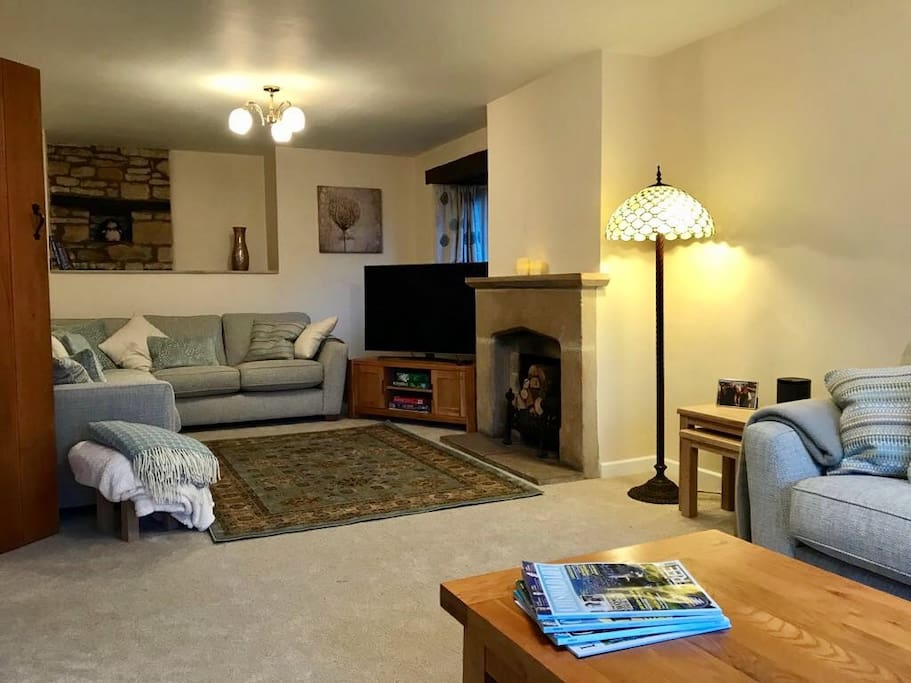 Lounge - Aspect 2 with corner sofa, large TV and log burner.