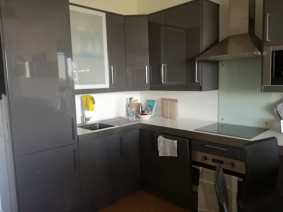 The dark-grey kitchen is equipped with all the amenities you might need. There is a coffee maker for your early morning coffee, a blender and a microwave/oven.
