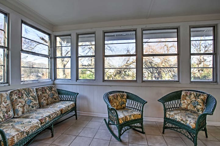 Enjoy a good book or conversation in the bright sunroom.