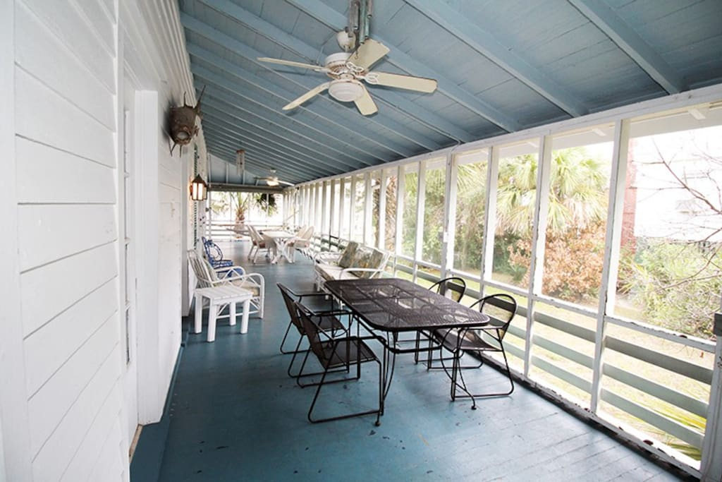Enjoy the ocean breezes on the screened porch that wraps around three sides of the house