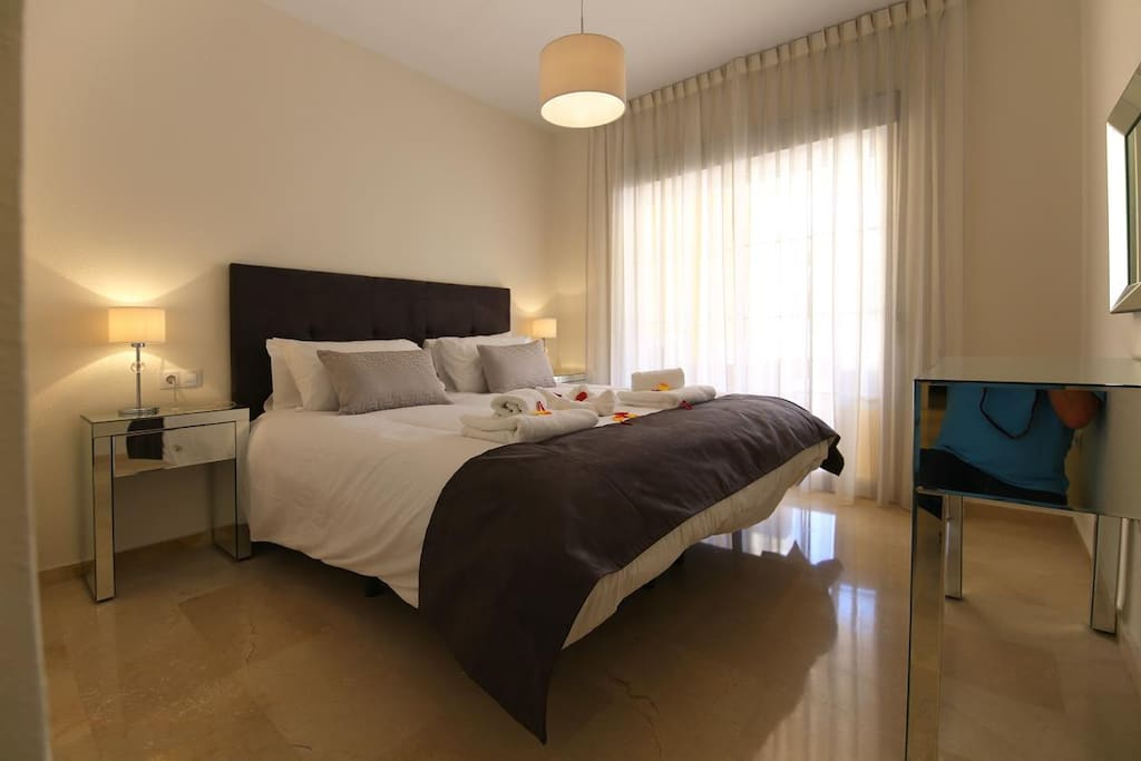 Comfortable master bedroom with terrace access