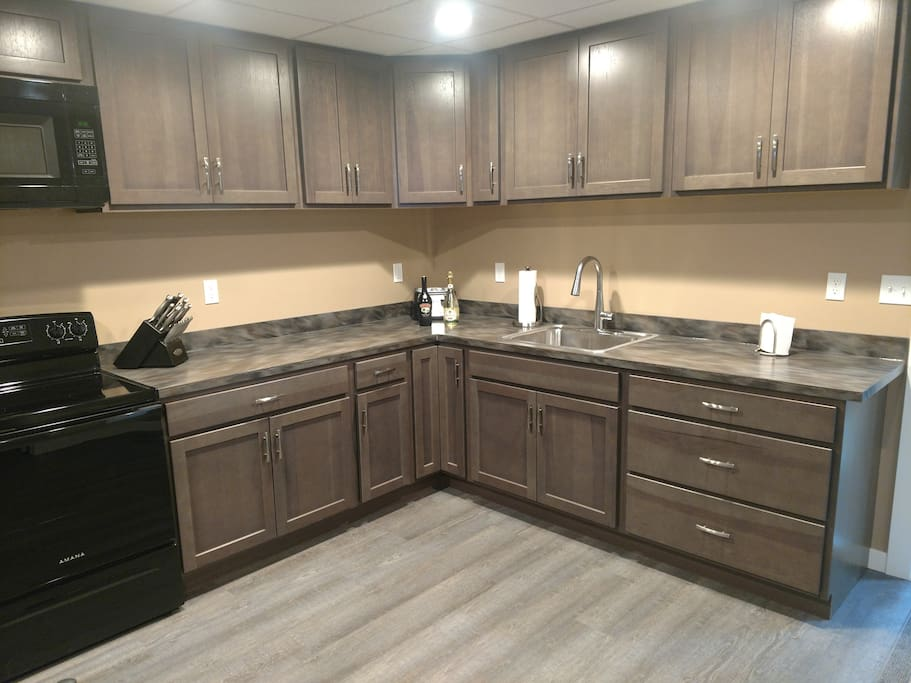 Spacious kitchen and new appliances. You will have access to the entire apartment and have parking immediately outside your front door.