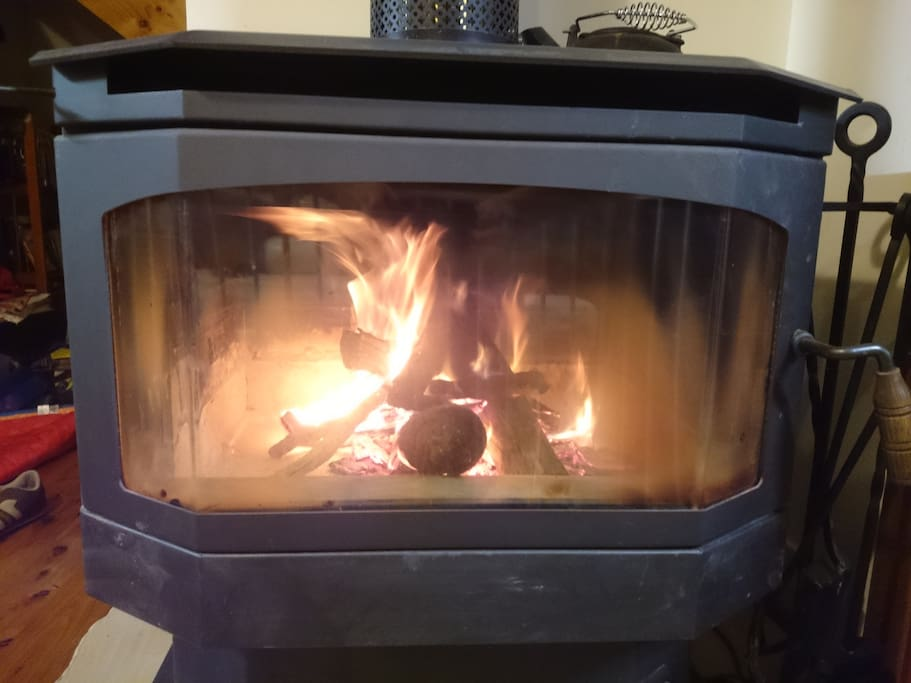 Large slow combustion fireplace for use from April -> October.