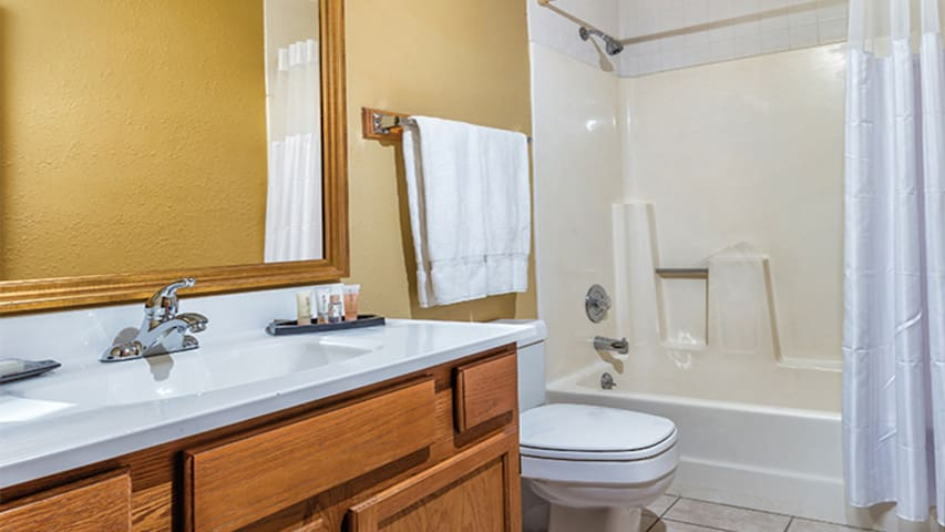 The bathroom is clean, spacious, and features a full-sized shower