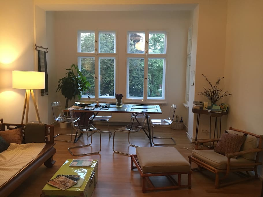 Big spacious living room with morning sun shining in for a perfect breakfast setting!