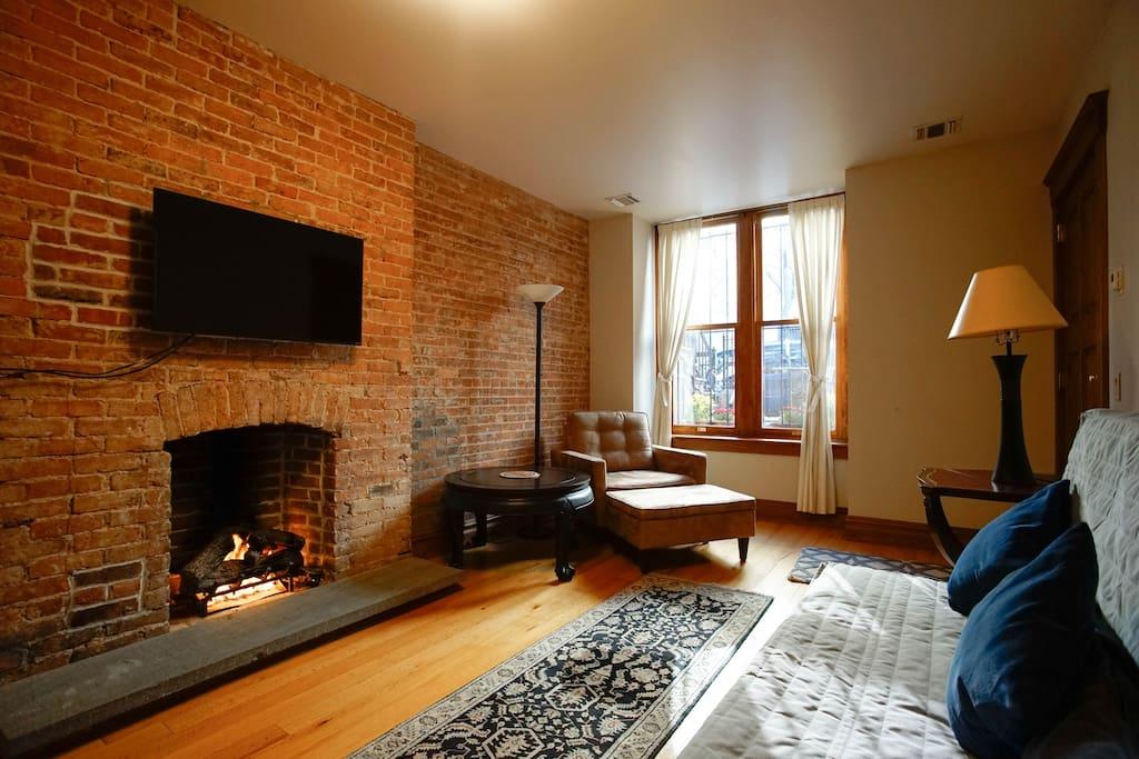 Cozy fire lit in living room.