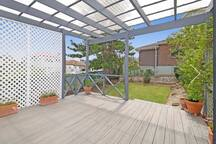 Hang outside with a lovely deck and garden