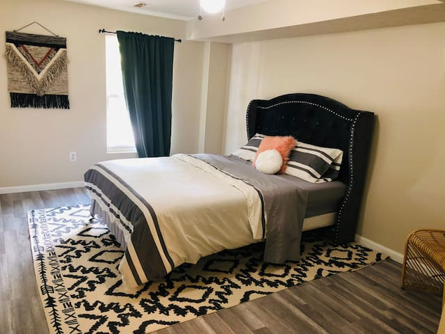 Master bedroom and attached bathroom lower level complete with a queen size bed, side chair and wall mounted flat screen tv. There is also a portable crib in the closet for use.