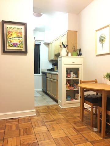 Breakfast nook and kitchen separated from living space. Includes oven/stove.