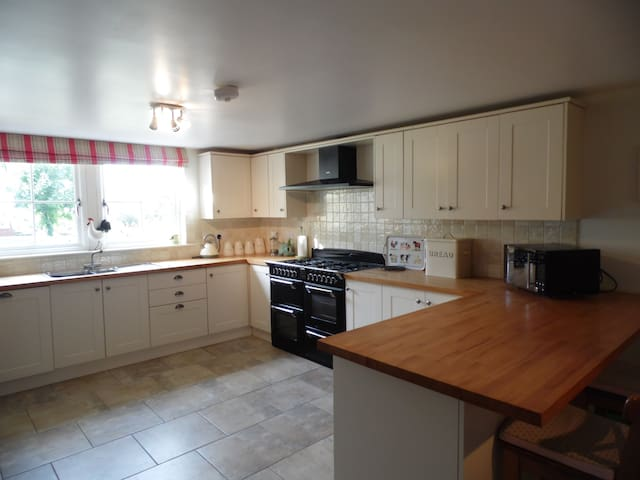 Large farmhouse kitchen with range cooker