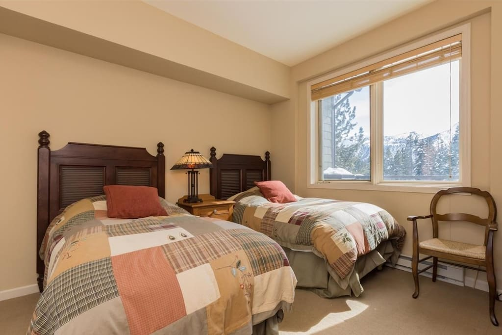 Bedroom on the main floor with two twin beds. Wake up to mountain views!
