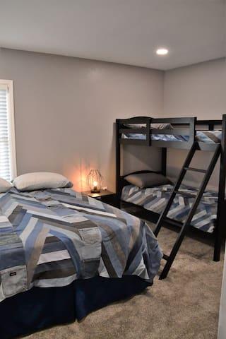 Main floor bedroom Queen bed and bunk beds