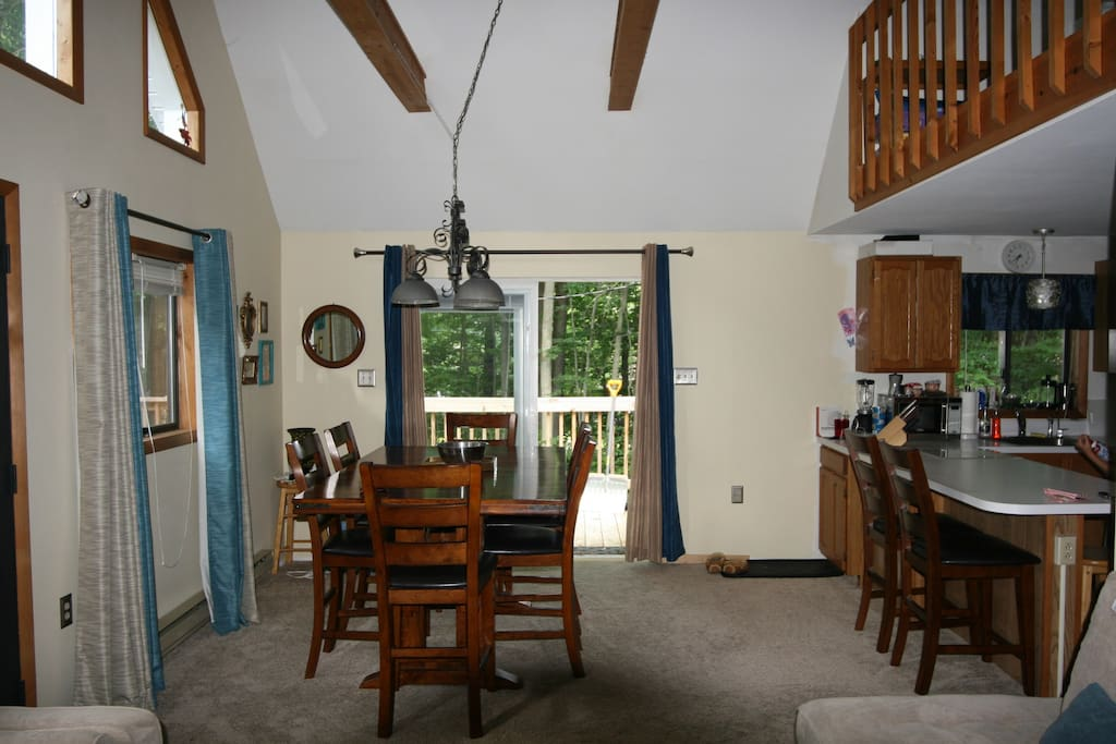 Dining room situated across from living room.