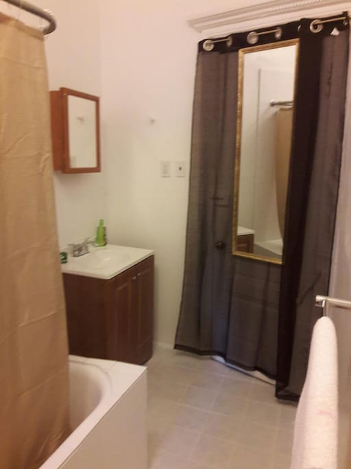 Private bath is freshly painted and re-tiled.