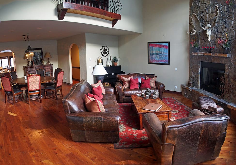 Well Appointed Living Room with Stone Fireplace and Plenty of Comfortable Seating