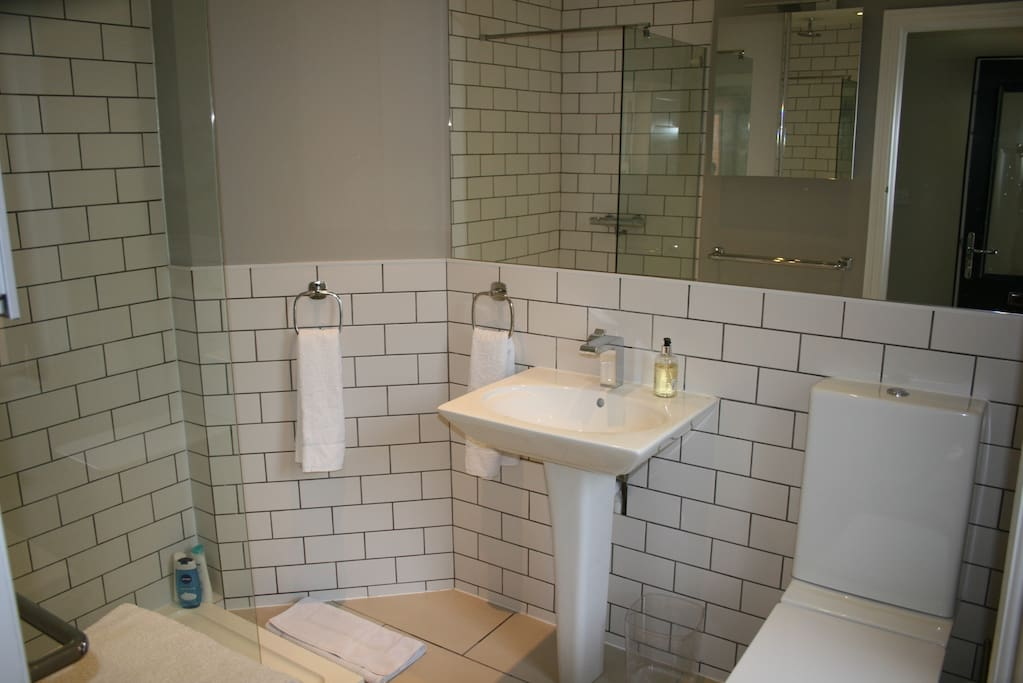 En suite with soaker shower and luxury white cotton towels