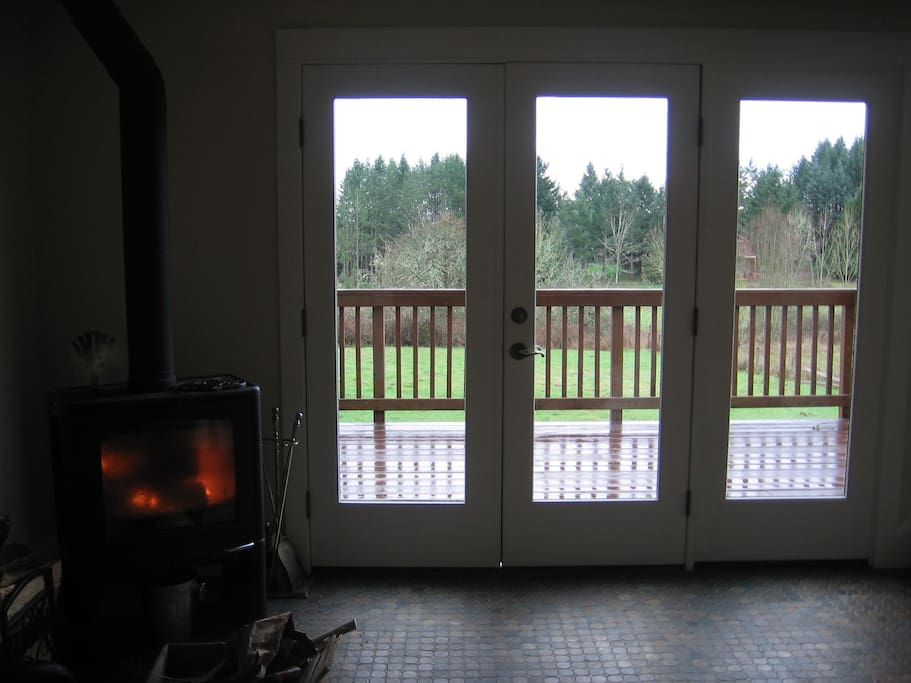 ...come in through the French door and into a cozy fireside sitting room...