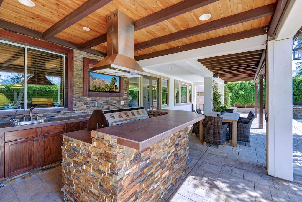 Outdoor kitchen with built in BBQ, TV, sink and full refrigerator