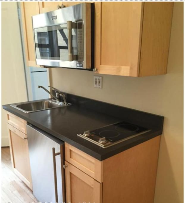Newly renovated and kitchen with high efficiency, stainless steel appliances. I have stocked the pantry with a few breakfast essentials like tea, oatmeal, and coffee. There is also sufficient cookware, plateware, and silverware for you to prep and enjoy your meals from home!