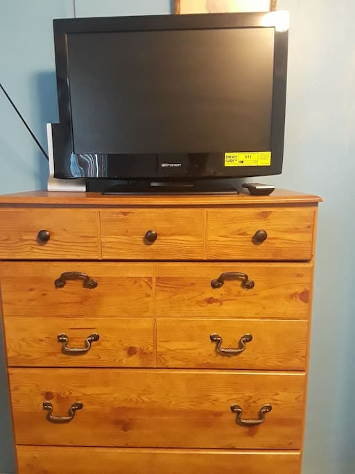 Chest of drawers and tv