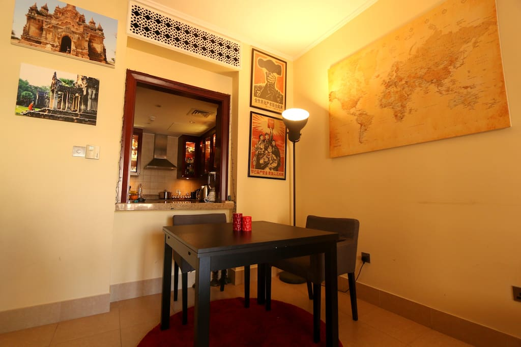 The apartment is full of decorative art and paintings from around the world