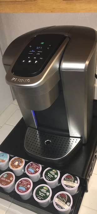 Latest model Keurig coffee maker with state of the art timer settings for your convenience and a variety of courtesy k-cups and creamer/sweetener to indulge in anytime.