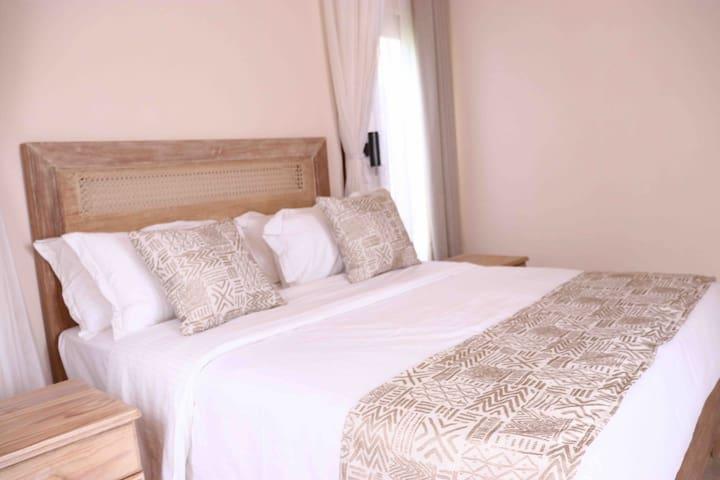 Bedroom 3 - Queen size bed in Lamu style Mvuli wood.