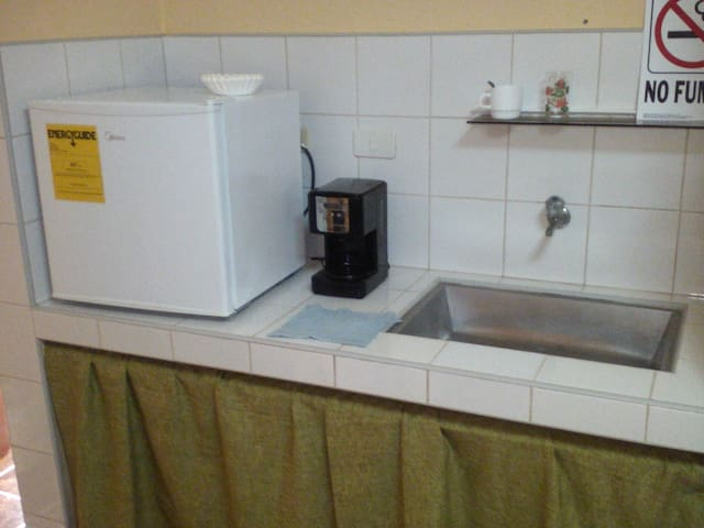 Rooms offer mini fridges and coffee makers