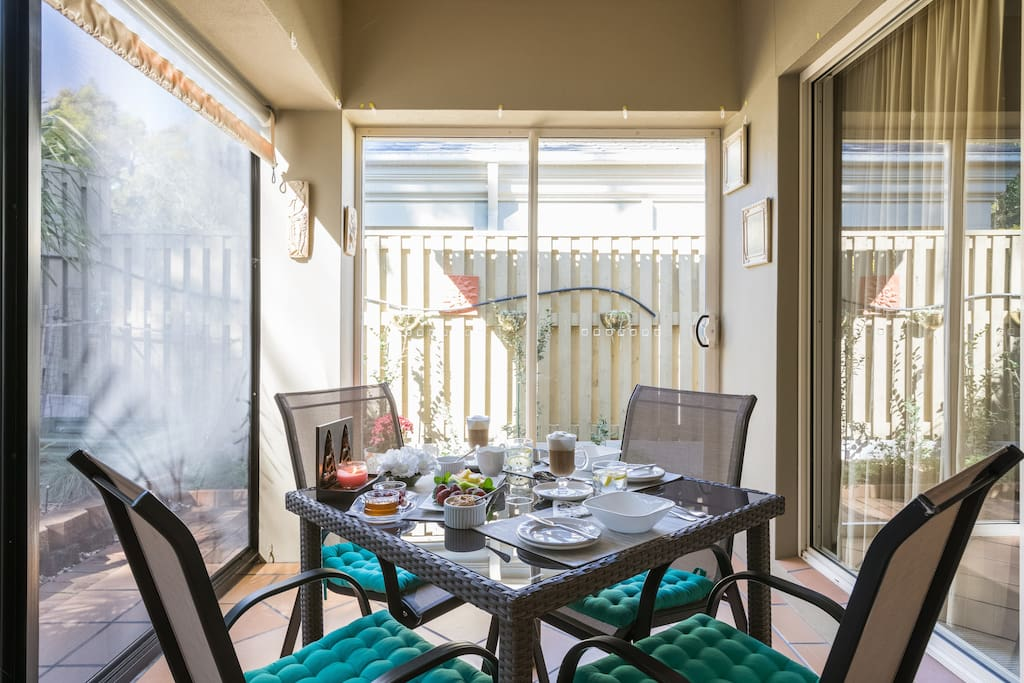 Enclosed patio area with BBQ. Here you can relax and enjoy breakfast and morning coffee.