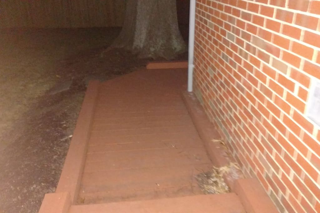 Wooden walkway leading to the basement apartment.
