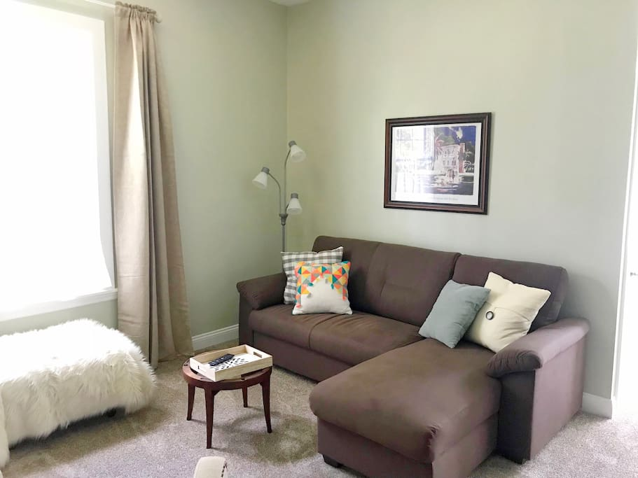 Couch in living area, facing TV