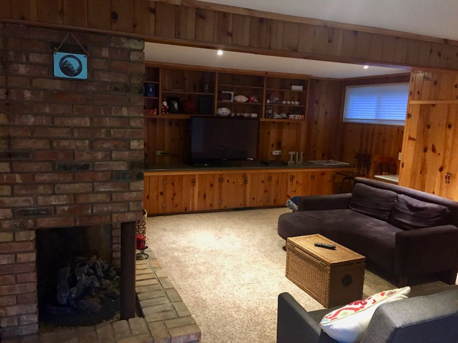 Large finished walk-out basement, one pull out couch and plenty of room for 3-4 air mattresses (additional room on left side of fireplace as well).