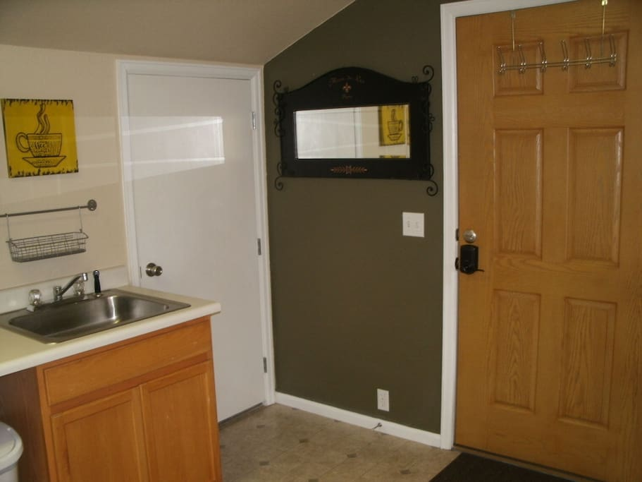 Front entry and closet with storage area