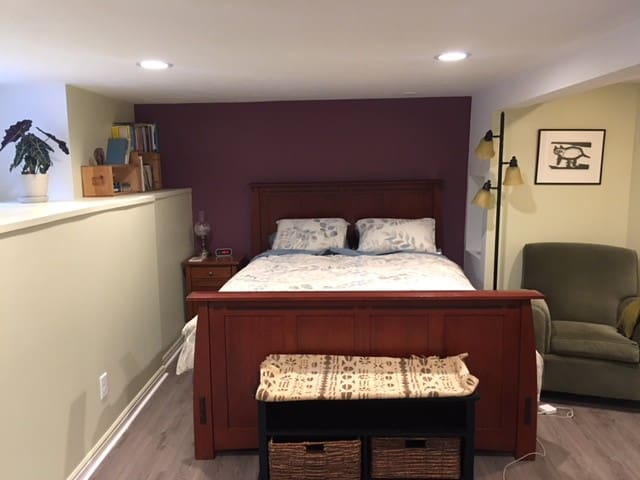 Comfy bed, new Queen mattress. South facing windows bring in lots of light even though this is a basement unit.
